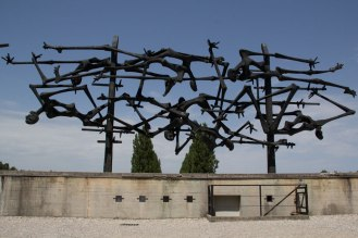 A sculpture showing people throwing themselves on the electric fence to escape.