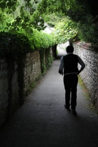 man walking down lane in giverny, france