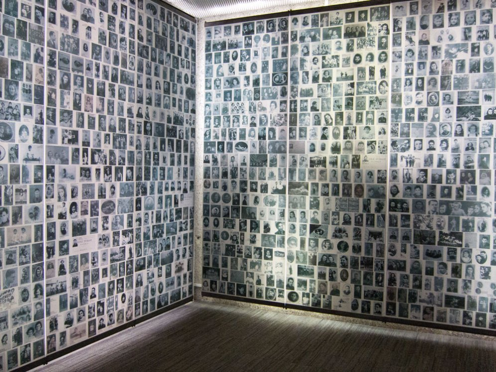 The wall is filled with pictures of the children of the holocaust.