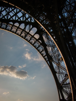 Light from the setting sun hitting the Eiffel Tower.